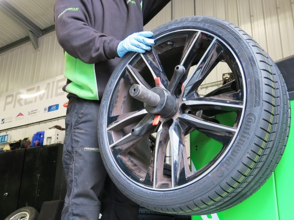 Wheel being balanced after new tyre fitted.
