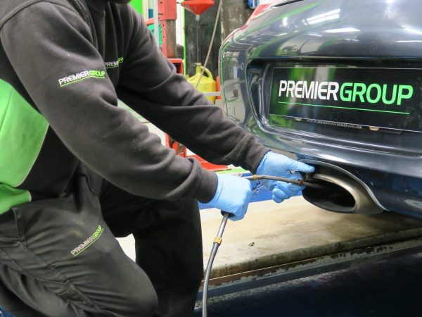 Exhaust probe checking emissions for MOT test