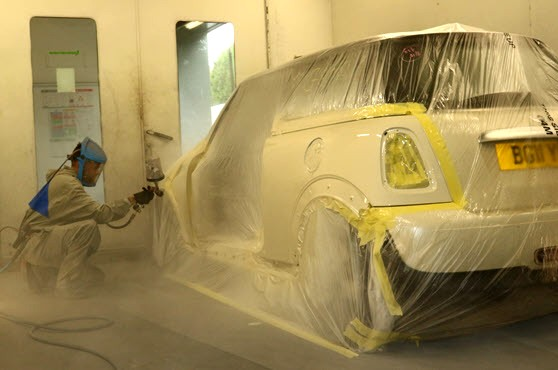 A Mini is in the booth fro spray painiting